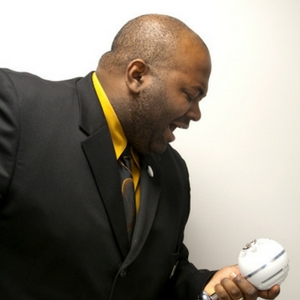 maurice coleman singing into a microphone